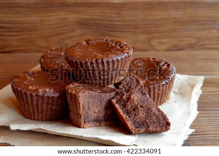 Chocolate sweet homemade cupcakes. Sweet pastries. Delicious chocolate cupcakes. Baking recipe. Closeup - stock photo