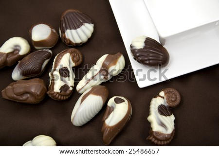 chocolate sweetmeats in form seashell and cup