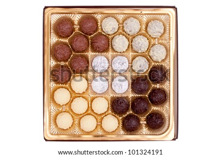 Chocolate sweets from above, isolated on white - stock photo