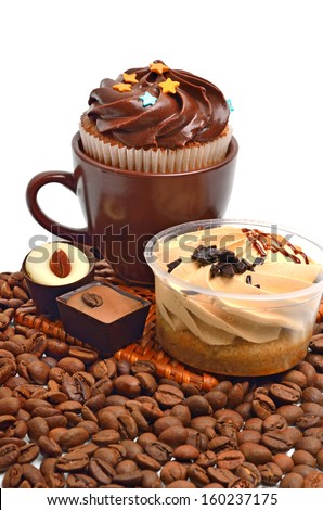 chocolate sweets, muffins and coffee beans isolated on white