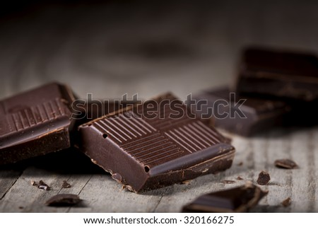 Chocolate sweets on rustic wooden background - stock photo