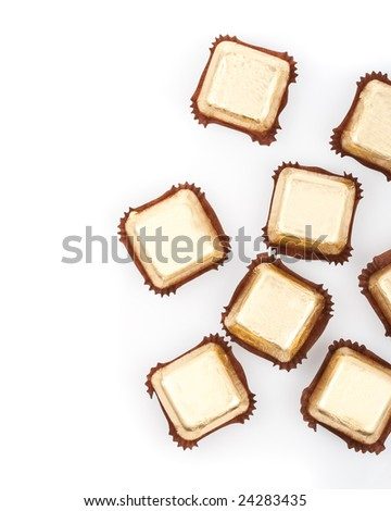 chocolate sweets on white background, top view - stock photo