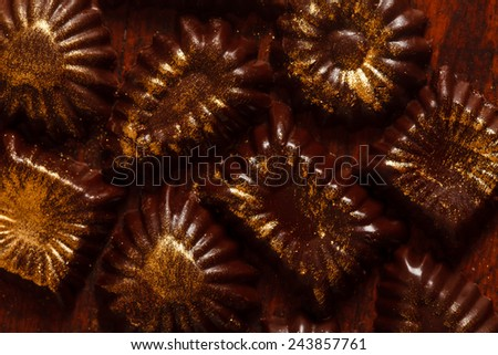 chocolate sweets with edible golden powdeer - stock photo