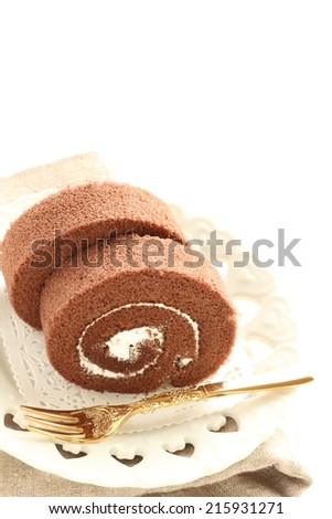 chocolate swiss roll with frozen grape - stock photo