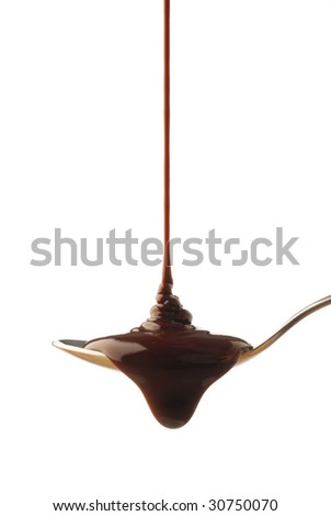 Chocolate syrup being poured onto a spoon - stock photo