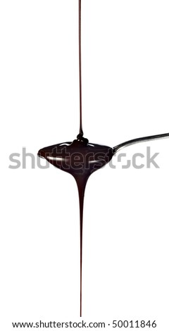chocolate syrup leaking from spoon on white background with clipping path - stock photo