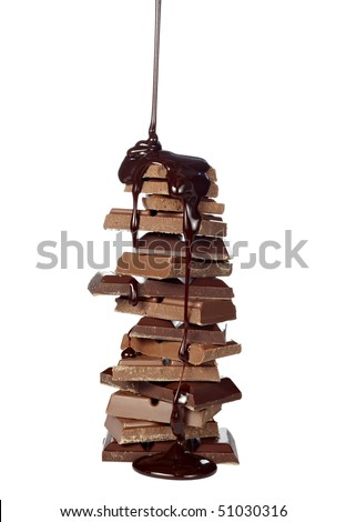 chocolate syrup leaking on stack of chocolate blocks on white background with clipping path - stock photo