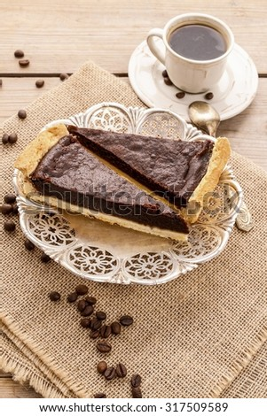 Chocolate tart and cup of coffee