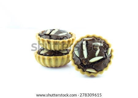 Chocolate tart with almonds on white background.
