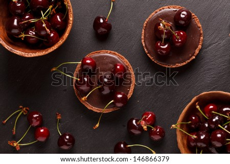 chocolate tart with cherry - stock photo