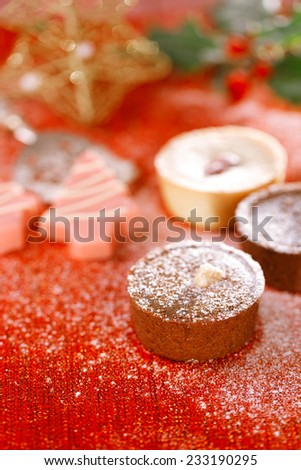 chocolate tartlets in festive golden red style, shallow dof - stock photo
