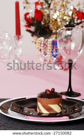 chocolate truffle cake with pink and black table setting
