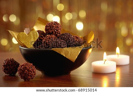 chocolate truffles and burning candles - stock photo