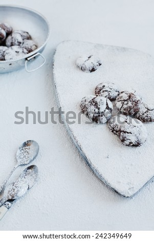 Chocolate truffles cookies on white wooden background. Selective focus. Rustic style.  - stock photo