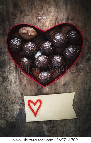 Chocolate truffles in heart shaped box on wood, valentine, mother's day present