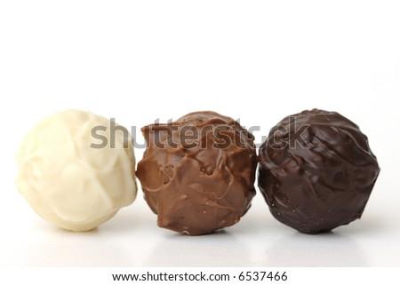 chocolate truffles on white - stock photo