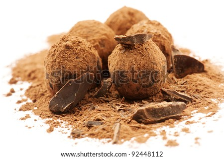 Chocolate truffles on white background - stock photo
