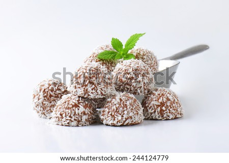 Chocolate truffles rolled in coconut flakes - stock photo