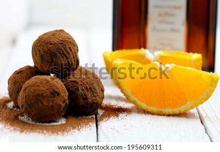 Chocolate truffles with orange and  triple sec - stock photo