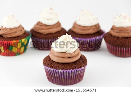 Chocolate two colored cupcakes - stock photo