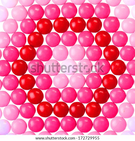 Chocolate Valentine's candy coated in pink, red and white. Background - stock photo