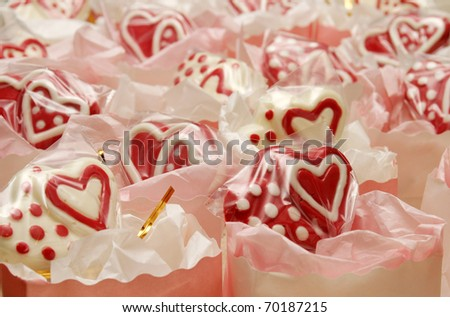 Chocolate Valentine suckers in bags - stock photo