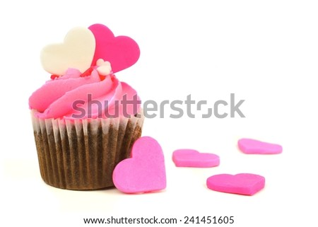 Chocolate Valentines Day cupcake with pink frosting and hearts over white - stock photo