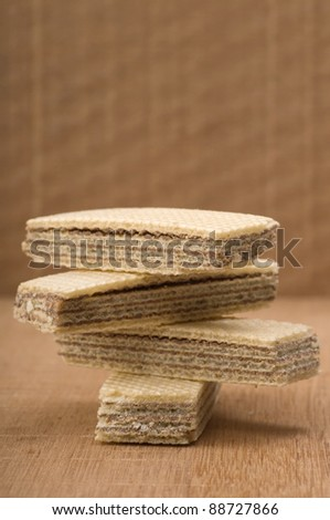 Chocolate wafer stacked and shot in the studio on wooden background