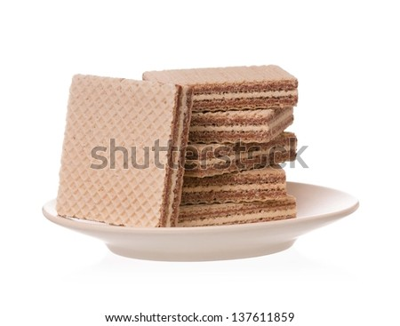 Chocolate wafers on a saucer isolated on a white background cutout - stock photo