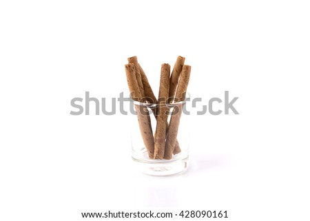 chocolate waffle rolls with chocolate cream,selective focus on white paper background - stock photo