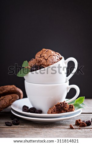 Chocolate walnut cherry cookies in coffee cups - stock photo