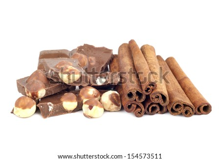 Chocolate with hazelnuts and cinnamon isolated on white background