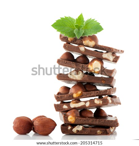 Chocolate with hazelnuts and mint leaves - stock photo
