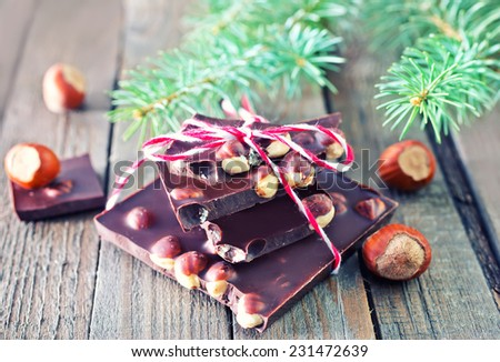 chocolate with nut and christmas tree on a table - stock photo