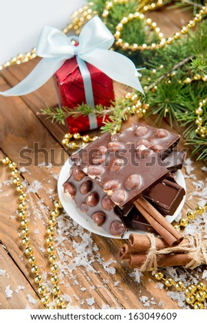 chocolate with nuts and cinnamon on the holiday table.  christmas decoration