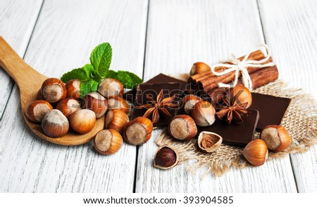 chocolate with nuts on a old wooden table - stock photo