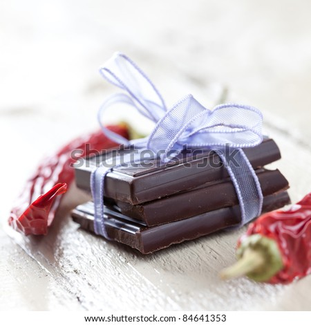 chocolate with ribbon and red pepper