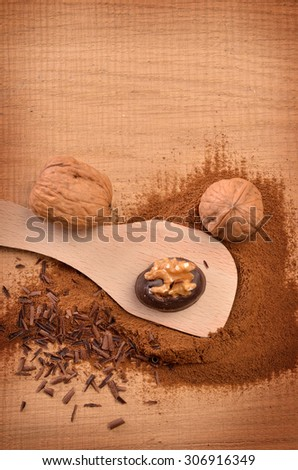 Chocolate with walnuts on a rustic wooden table