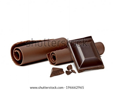 Chocolates and curls on white background - stock photo