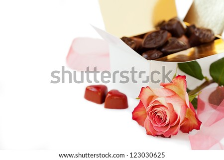 Chocolates and pink rose - stock photo