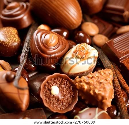 Chocolates background. Chocolate. Assortment of fine chocolates in white, dark, and milk chocolate. Praline Chocolate sweets - stock photo