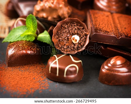 Chocolates. Chocolate. Assortment of fine chocolate praline in dark and milk chocolate with vanilla and mint. Variety of Chocolate sweets - stock photo