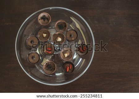 Chocolates in a luxurious glass dish. Various sweets. Bulgaria