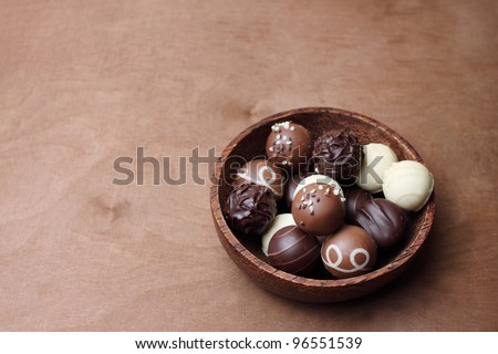 chocolates in a wooden bowl - stock photo