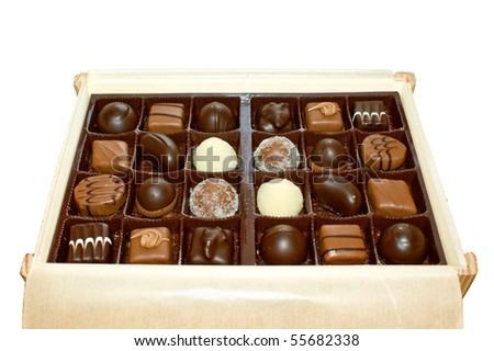 Chocolates in a wooden box isolated - stock photo