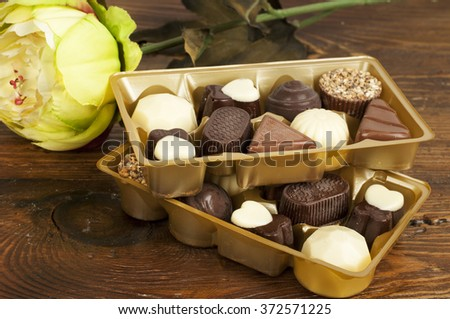 chocolates in the golden box - stock photo