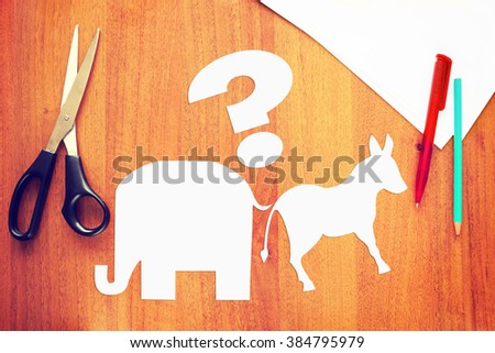 Choice between the Democratic and Republican parties in the elections. Conceptual image with paper scrapbooking - stock photo
