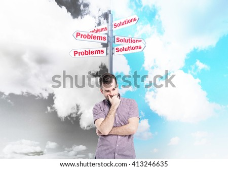 Choice concept with thoughtful caucasian man and direction signs. Sky background divided into black-and-white and blue