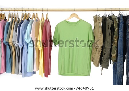 Choice of casual clothes on wooden hangers and trousers - stock photo