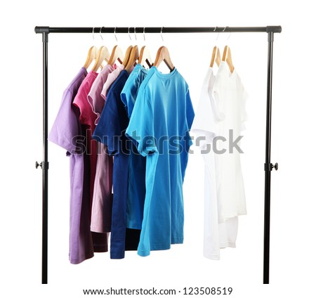 Choice of clothes of different colors on wooden hangers, isolated on white - stock photo